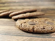 Chocolate chip cookies on a woodenn rustic table calories homemade desser. T tradition stock image