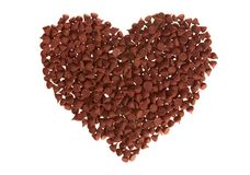 Chocolate Chip Heart (isolated). Milk chocolate chips arranged into a heart shape and isoalted on white stock image