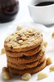 The chocolate chip and macadamia cookies on dish set for coffee break Royalty Free Stock Photo