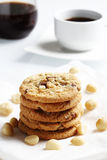 The chocolate chip and macadamia cookies on dish set for coffee break Stock Images