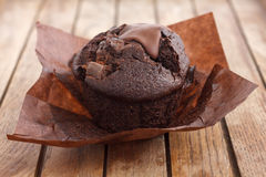 Chocolate chip muffin in brown wax paper. Unwrapped Stock Photo