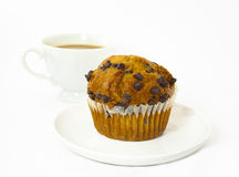 Chocolate chip muffin and coffee. Isolated on a white background Stock Photos