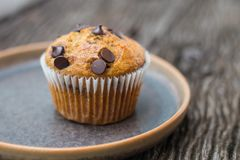 Chocolate chip muffins. On wooden background Stock Photo