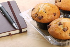 Chocolate Chip Muffins and Notepad Royalty Free Stock Images
