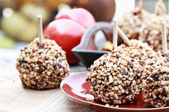Chocolate Chip and Nut Covered Carmel Apples Stock Image