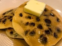 Chocolate Chip. Pancakes with butter and maple syrup royalty free stock images
