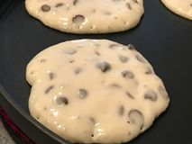 Chocolate Chip Pancakes on the Griddle.  Stock Images
