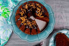 Chocolate chip pound cake sliced with chocolate glaze on top. Chocolate chip pound cake sliced with chocolate glaze and orange on top frosting dessert sweet dark stock photography