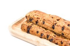 Chocolate chip stick bread with wood plate on white background. stock photos
