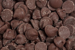 Chocolate Chips. A closeup of a bunch of chocolate chips Stock Image