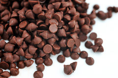 Chocolate chips. Dark chocolate chips on a white background Royalty Free Stock Images