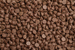 Chocolate chips. Background food texture of chocolate chips Stock Photos