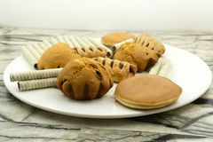 Chocolate chips banana muffins on rustic background stock image
