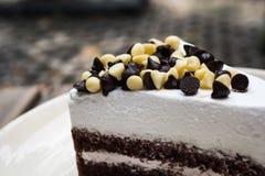 Chocolate chips on chocolate cake. Closeup shot of chocolate chips on chocolate cake Stock Photography