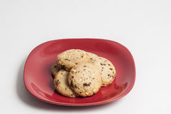 Chocolate chips cookies. On a red plate ready to serve royalty free stock photography