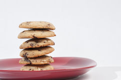 Chocolate chips cookies. On a red plate ready to serve stock photography