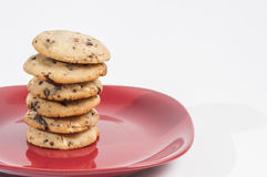 Chocolate chips cookies. On a red plate ready to serve royalty free stock photo