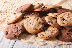 Chocolate chips cookies close-up on a lace doily. horizontal. Homemade chocolate chips cookies close-up on a lace doily. horizontal Stock Images