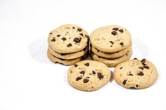 Chocolate chips cookies good food set out. A cookie is a baked or cooked food that is small, flat and sweet. It usually contains flour, sugar and some type of Royalty Free Stock Photo