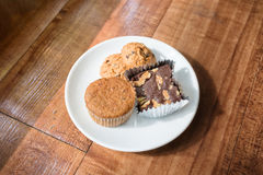 Chocolate chips cookies on a white plateChocolate chips cookies and brownie on a white plate Royalty Free Stock Images