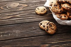 Chocolate chips cookies on a wooden background royalty free stock photography