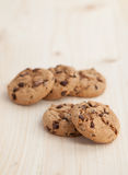 Chocolate chips cookies on a wooden table Royalty Free Stock Images