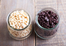 Chocolate chips. Drops in glasses Royalty Free Stock Photos