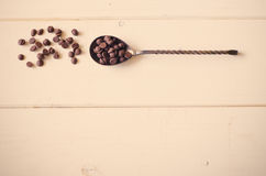 Chocolate chips. On light wood background. toning Royalty Free Stock Images