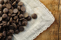 Chocolate Chips on a Rustic Surface Stock Photo