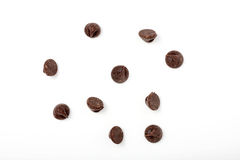 Chocolate chips scattered on white background Stock Photo