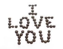 Chocolate Chips spelling I love you. Isolated chocolate chips arranged to spell I love you Royalty Free Stock Image
