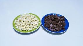 Chocolate chips. Wonderful homemade chocolate chips, black and white Stock Image