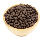 Chocolate Chips. In a wood bowl  isolated on white background Royalty Free Stock Photography