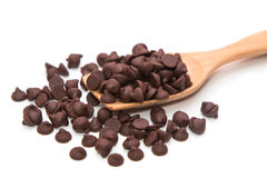 Chocolate chips in wooden spoon Royalty Free Stock Photography