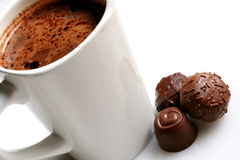 Chocolate on Chocolate. A mug of hot chocolate, with three assorted chocolates alongside royalty free stock photo