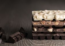 Chocolate / Chocolate bar on dark wooden background.  Royalty Free Stock Images