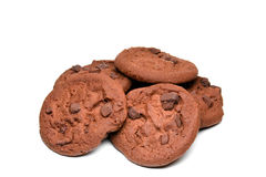 Chocolate Chocolate Chip Cookies. A pile of chocolate chocolate chip cookies isolated on a white background Royalty Free Stock Photos