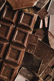 Chocolate chocolate chunks. Chocolate bar pieces. large bar of chocolate on wooden background. Chocolate candies. Background wit Royalty Free Stock Photos