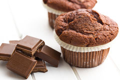 Chocolate and chocolate muffin. On kitchen table Stock Photos