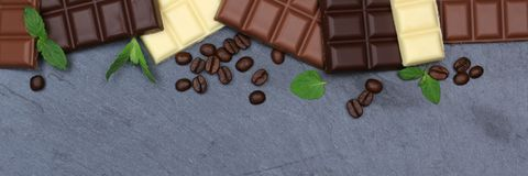 Chocolate chocolates bar food slate banner copyspace top view Royalty Free Stock Image
