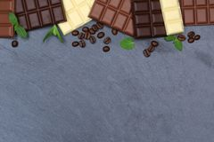 Chocolate chocolates bar food slate copyspace top view Stock Images