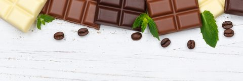 Chocolate chocolates bar food sweets banner copyspace wood top v Royalty Free Stock Photos