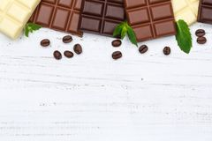 Chocolate chocolates bar food sweets copyspace wood top view Stock Images