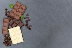 Chocolate chocolates bar food sweets slate copyspace top view Royalty Free Stock Photo