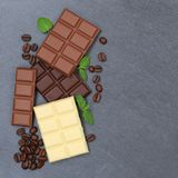 Chocolate chocolates bar food sweets slate square copyspace top Royalty Free Stock Image