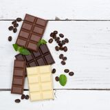 Chocolate chocolates bar food sweets square copyspace top view Royalty Free Stock Images