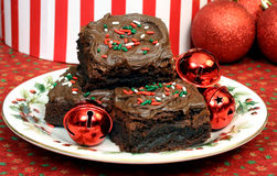 Chocolate Christmas Brownies. Chocolate frosted Christmas fudge brownies on a festive holiday plate Stock Images