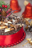 Chocolate christmas cake portrait with twirl topping and red rib Stock Photography