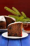 Chocolate christmas fruit cake and fur brunch on blue table Stock Photos