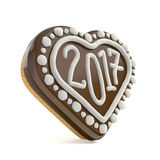 Chocolate Christmas gingerbread heart shape decorated with 2017. Stock Photography